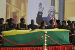 Mourners pay their respects at the coffin of former United Nations Secretary-General Kofi Annan at the Accra International Conference Center in Ghana on Sept. 11, 2018. Annan died in Switzerland at age 80. (AP Photo/Sunday Alamba)