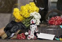 A makeshift memorial is shown at the base of a statue of former President George H.W. Bush in downtown Houston, Sunday, Dec. 2, 2018. Bush is returning to Washington as a revered political statesman, hailed by leaders across the political spectrum and around the world as a man not only of greatness but also of uncommon decency and kindness.  Bush, died late Friday at his Houston home at age 94, is to be honored with a state funeral at National Cathedral in the nation's capital on Wednesday, followed by burial Thursday on the grounds of his presidential library at Texas A&M. (AP Photo/David J. Phillip)