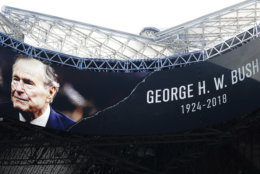 A tribute for Former President George H.W. Bush is seen before the first half of an NFL football game between the Atlanta Falcons and the Baltimore Ravens, Sunday, Dec. 2, 2018, in Atlanta. Bush died late Friday at his Houston home at age 94. (AP Photo/John Bazemore)