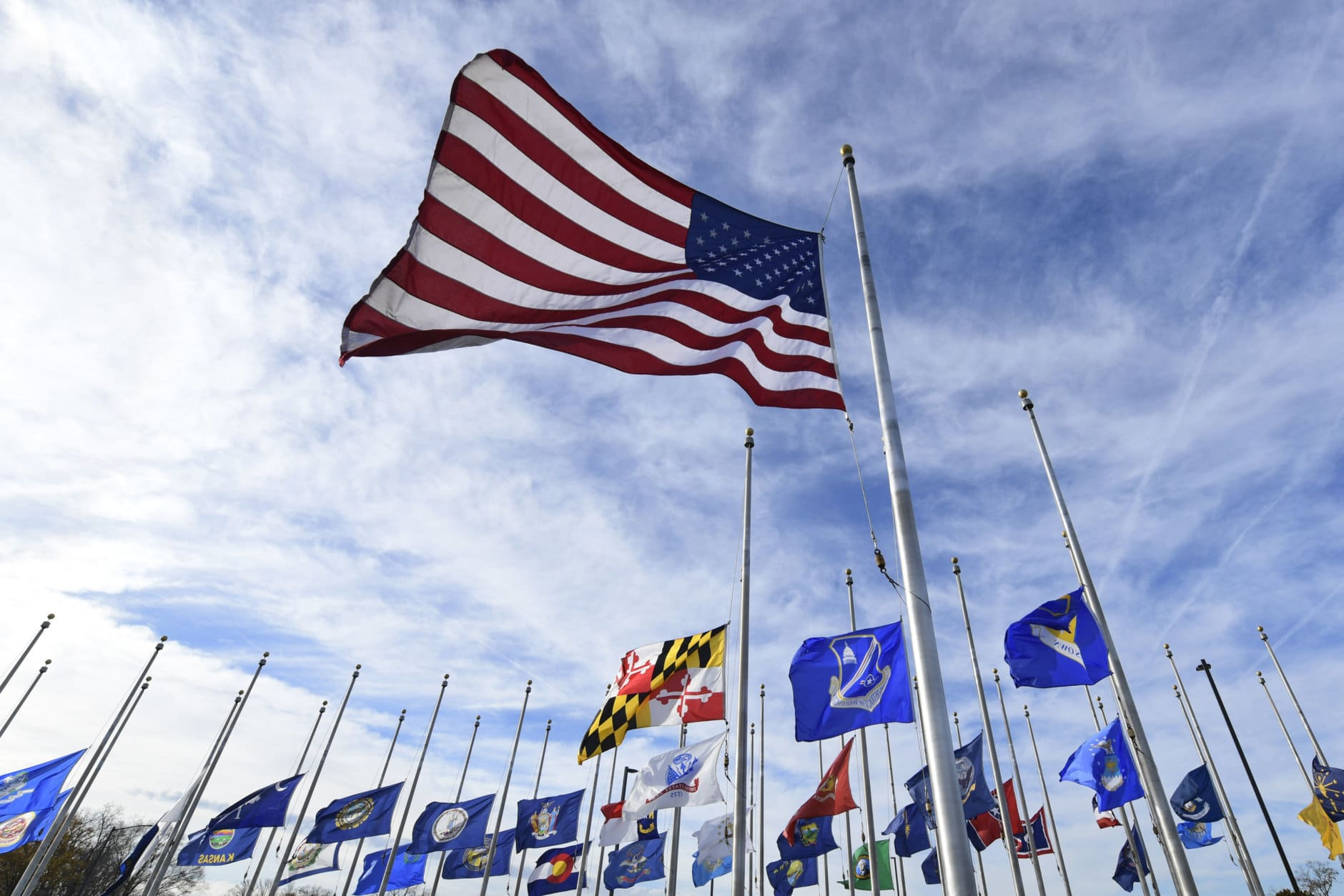 Flags fly at half-staff at Andrews Air Force Base in Md., Monday, Dec. 3, 2018, in honor of former President George H.W. Bush. An outpouring is anticipated in Washington this week during the state funeral for Bush, who died late Friday at his home in Houston. He was 94. (AP Photo/Susan Walsh)