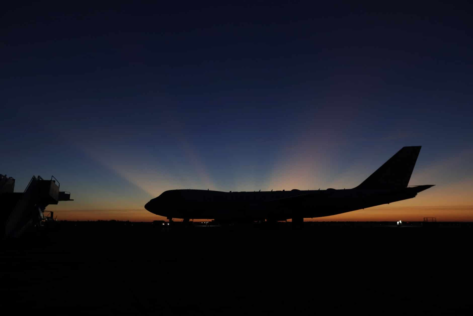 The sun rises behind Special Air Mission 41, the plane that will transfer the casket of former President George H.W. Bush to Washington,D.C., Monday, Dec. 3, 2018, in Houston. Bush, died late Friday at his Houston home at age 94, is to be honored with a state funeral at National Cathedral in the nation's capital on Wednesday, followed by burial Thursday on the grounds of his presidential library at Texas A&M. (AP Photo/Eric Gay)
