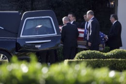 Members of the U.S. Secret Service carry the casket with former President George H. W. Bush to a hearse at George H. Lewis Funeral Home after a family service, Monday, Dec. 3, 2018, in Houston. Monday, Dec. 3, 2018, in Houston. (AP Photo/Kiichiro Sato)