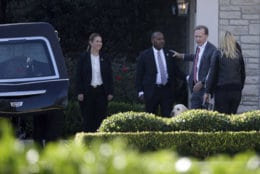 Neil Bush, right, greets members of the U.S. Secret Service after the casket of former President George H. W. Bush was placed into a hearse at the George H. Lewis Funeral Home following a family service, Monday, Dec. 3, 2018, in Houston.  (AP Photo/Kiichiro Sato)