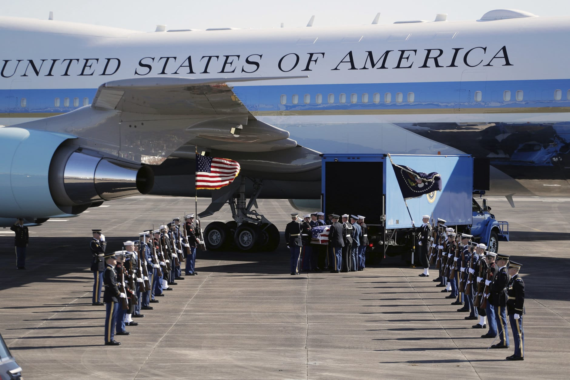 Members of the military carry the casket to Special Air Mission 41 at Ellington Field during a departure ceremony for a state funeral for former President George H.W. Bush, Monday, Dec. 3, 2018, in Houston. (AP Photo/Eric Gay)