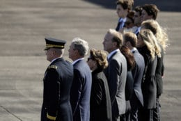 Family members of former President George H.W. Bush, including former President George W. Bush, second from left, watch as members of the military carry the casket to Special Air Mission 41at Ellington Field during a departure ceremony for a state funeral, Monday, Dec. 3, 2018, in Houston. (AP Photo/Eric Gay)