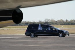The hearse carrying the flag-draped casket of former President George H.W. Bush arrives at Ellington Field for a departure ceremony Monday, Dec. 3, 2018, in Houston. (AP Photo/David J. Phillip, Pool)