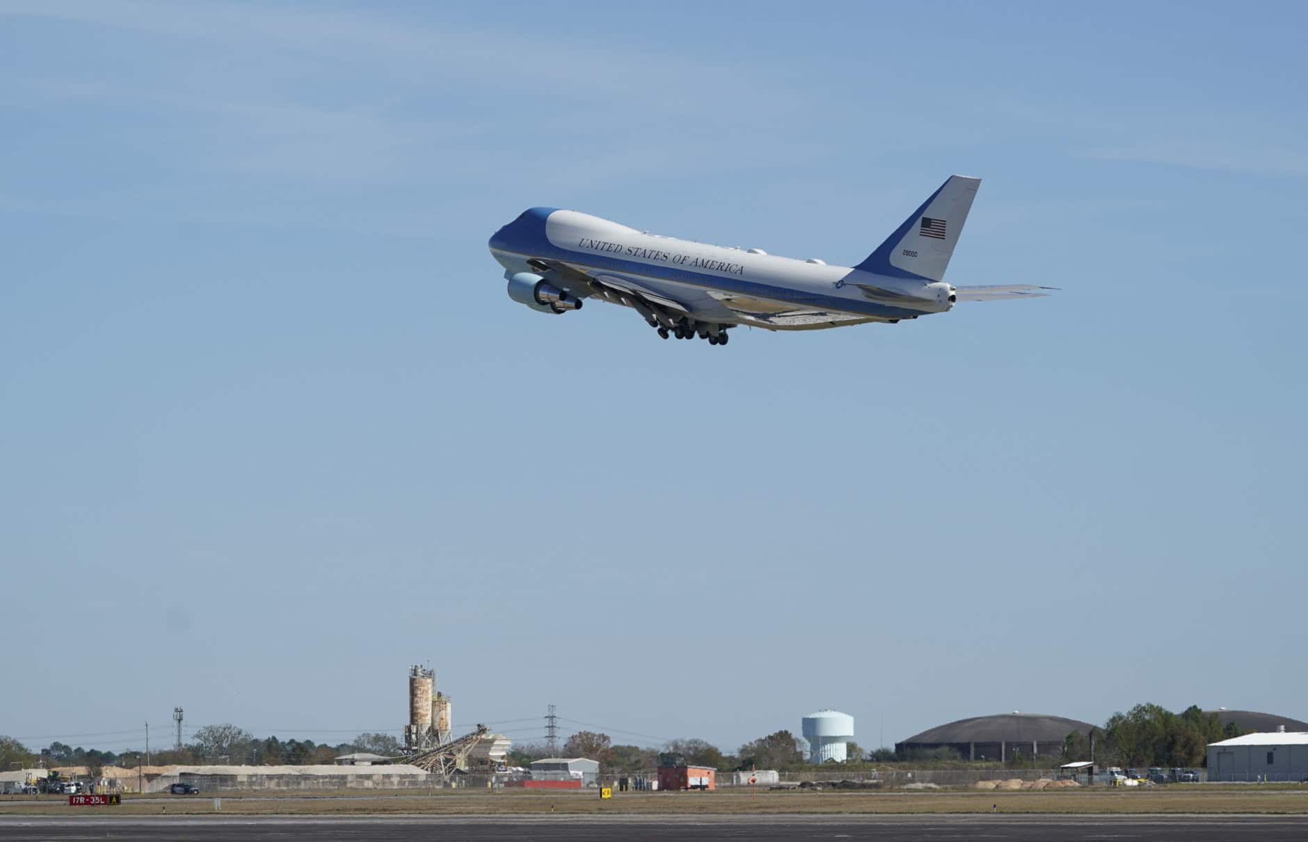 The plane carrying former President George H.W. Bush takes off from Ellington Filed Monday, Dec. 3, 2018, in Houston, as it heads to Washington. (AP Photo/David J. Phillip, Pool)