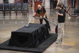 Mike Dean, lead upholsterer for the House of Representatives, and John Brady Jr., an apprentice, prepare the Lincoln Catafalque for the casket of former President George H.W. Bush, who died Friday at age 94, in the Capitol Rotunda in Washington, Monday, Dec. 3, 2018. (AP Photo/J. Scott Applewhite)