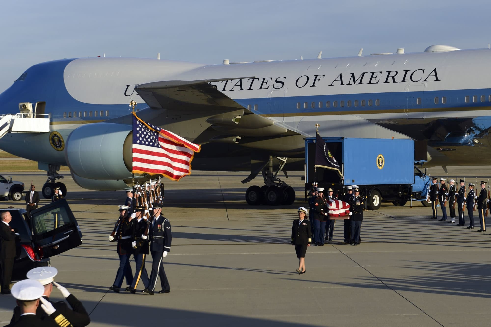 The flag-draped casket of former President George H.W. Bush is carried by a joint services military honor guard during an arrival ceremony Monday, Dec. 3, 2018, at Andrews Air Force Base, Md. (AP Photo/Susan Walsh)