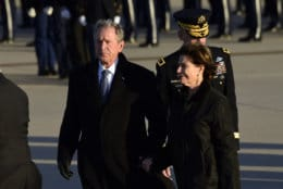 Former President George W. Bush and former first lady Laura Bush arrive at Andrews Air Force Base in Md., Monday, Dec. 3, 2018, escorting the flag-draped casket of former President George H.W. Bush. (AP Photo/Susan Walsh)