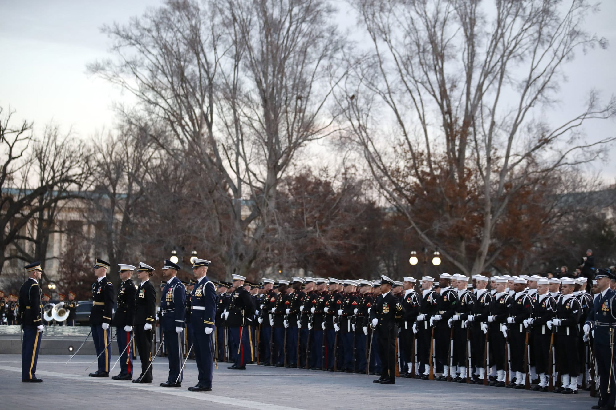 Military members watch as the casket of former President H.W. Bush arrives the U.S. Capitol, Monday, Dec. 3, 2018, in Washington. (AP Photo/Alex Brandon, Pool)