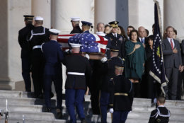 The flag-draped casket of former President George H.W. Bush is carried by a joint services military honor guard to lie in state in the rotunda of the U.S. Capitol, Monday, Dec. 3, 2018, in Washington. (AP Photo/Alex Brandon, Pool)