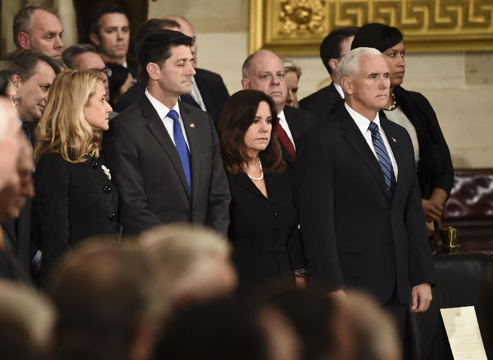 Vice President Mike Pence, from right, his wife Karen Pence, Speaker of the House of Representatives Paul Ryan, R-Wis., and his wife Janna Ryan wait for the arrival of the casket of former President George H.W. Bush at the Capitol in Washington, Monday, Dec. 3, 2018. (Brendan Smialowski/Pool Photo via AP)