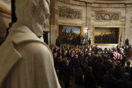 The casket bearing the remains of former President George H.W. Bush arrives at the Capitol in Washington, Monday, Dec. 3, 2018. (Brendan Smialowski/Pool Photo via AP)
