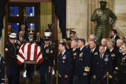 The casket bearing the remains of former President George H.W. Bush arrives at the Capitol in Washington, Monday, Dec. 3, 2018. (Brendan Smialowski/Pool Photo via AP)