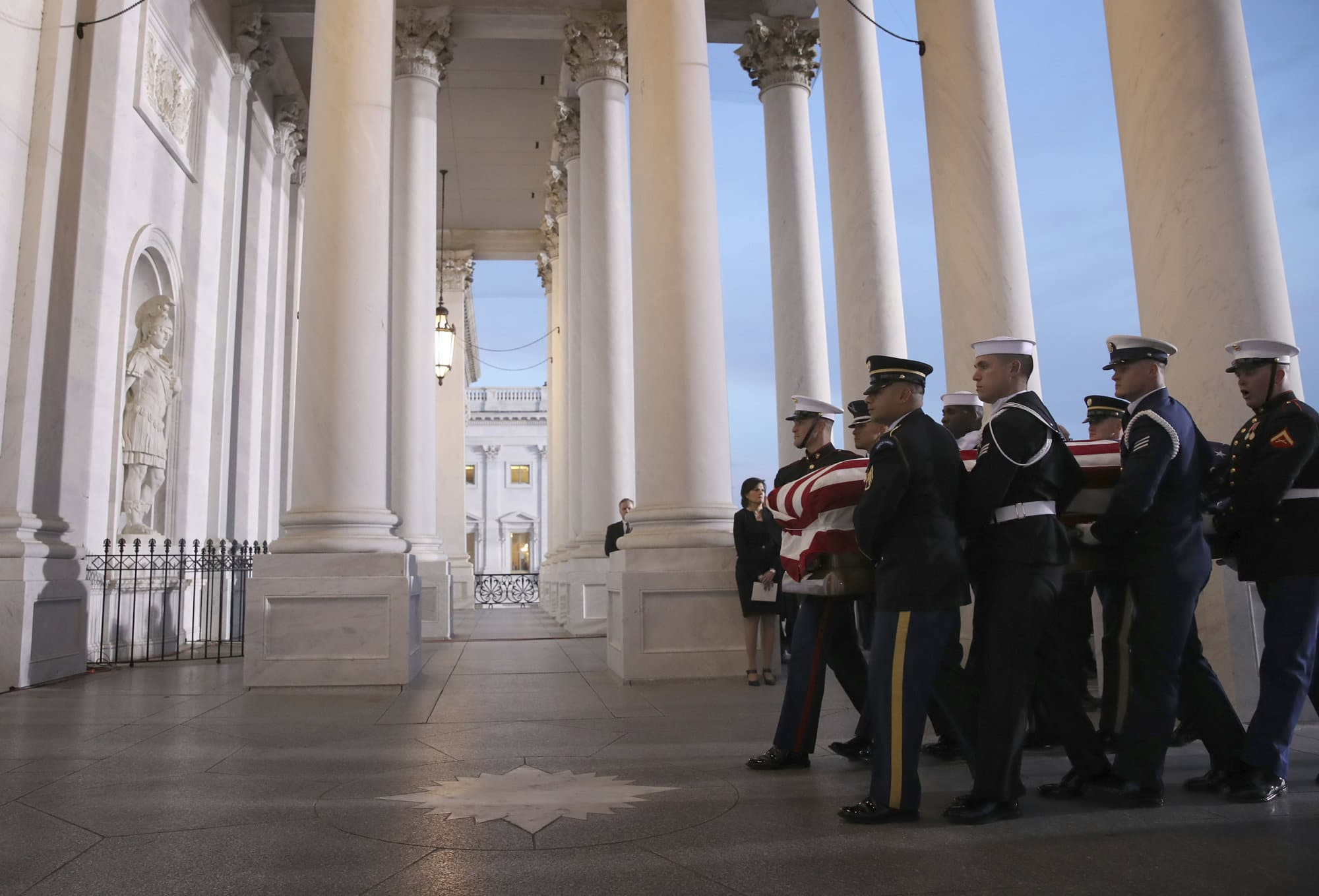 A military honor guard carries the casket of former President George H. W. Bush into the Capitol, Monday, Dec. 3, 2018 in Washington. (Win McNamee/Pool via AP)