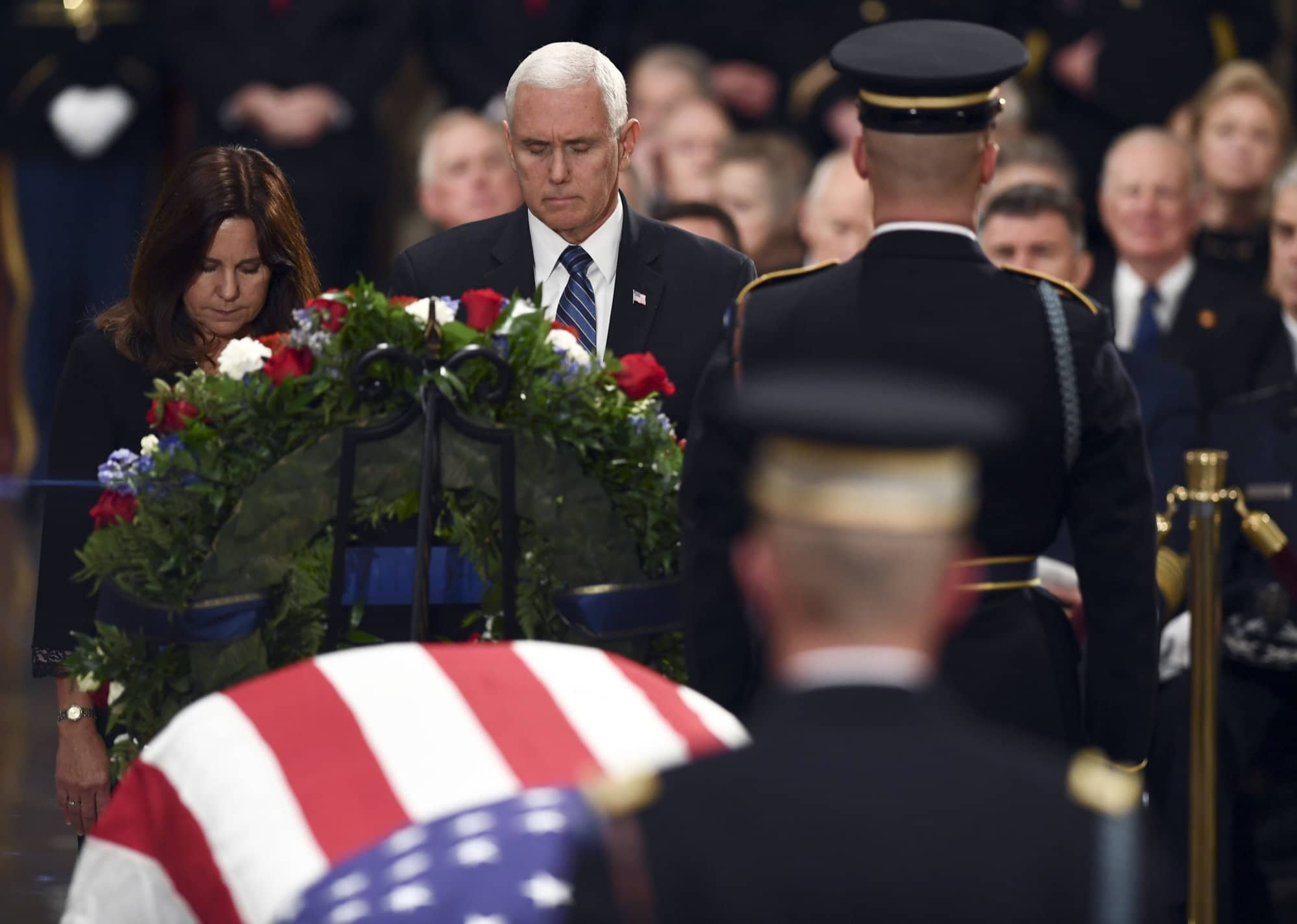 Vice President Mike Pence and Karen Pence, left, pay their respects as former President George H.W. Bush lies in state at the U.S. Capitol in Washington, Monday, 3, 2018. (Brendan Smialowski/Pool Photo via AP)