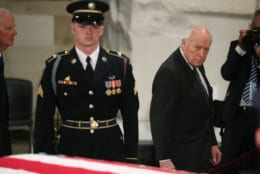 Former Vice President Dick Cheney walks past the casket of former President George H.W. Bush at the Capitol in Washington, Monday, Dec. 3, 2018. (Jonathan Ernst/Pool Photo via AP)