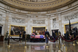 The flag-draped casket of former President George H.W. Bush lying in state at the U.S. Capitol Rotunda, Monday, Dec. 3, 2018, in Washington. (AP Photo/Pablo Martinez Monsivais)