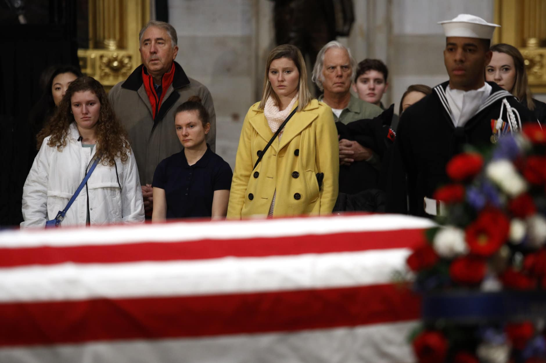 Visitors file past the flag-draped casket of former President George H.W. Bush as he lies in state in the Capitol Rotunda in Washington, Tuesday, Dec. 4, 2018. (AP Photo/Patrick Semansky)