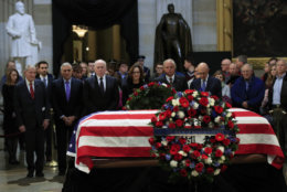 CIA Director Gina Haspel together with former CIA Directors, from left, William Webster, George Tenet, John Brennan, Haspel, Porter Goss and James Woolsey, pay their last respect to former President George H.W. Bush as he lie in state at the U.S. Capitol in Washington, Tuesday, Dec. 4, 2018.  (AP Photo/Manuel Balce Ceneta)
