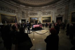 The last group of visitors pay their last respects to former President George H.W. Bush lying in state at the U.S. Capitol in Washington, Wednesday, Dec. 5, 2018. (AP Photo/Manuel Balce Ceneta)