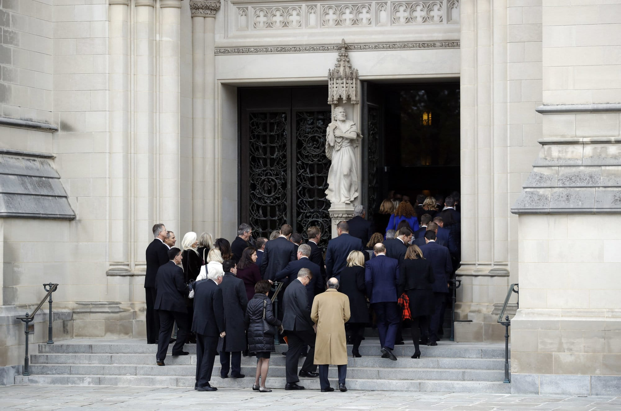 Mourners file into the Washington National Cathedral before a State Funeral for former President George H.W. Bush in Washington, Wednesday, Dec. 5, 2018. (AP Photo/Patrick Semansky)