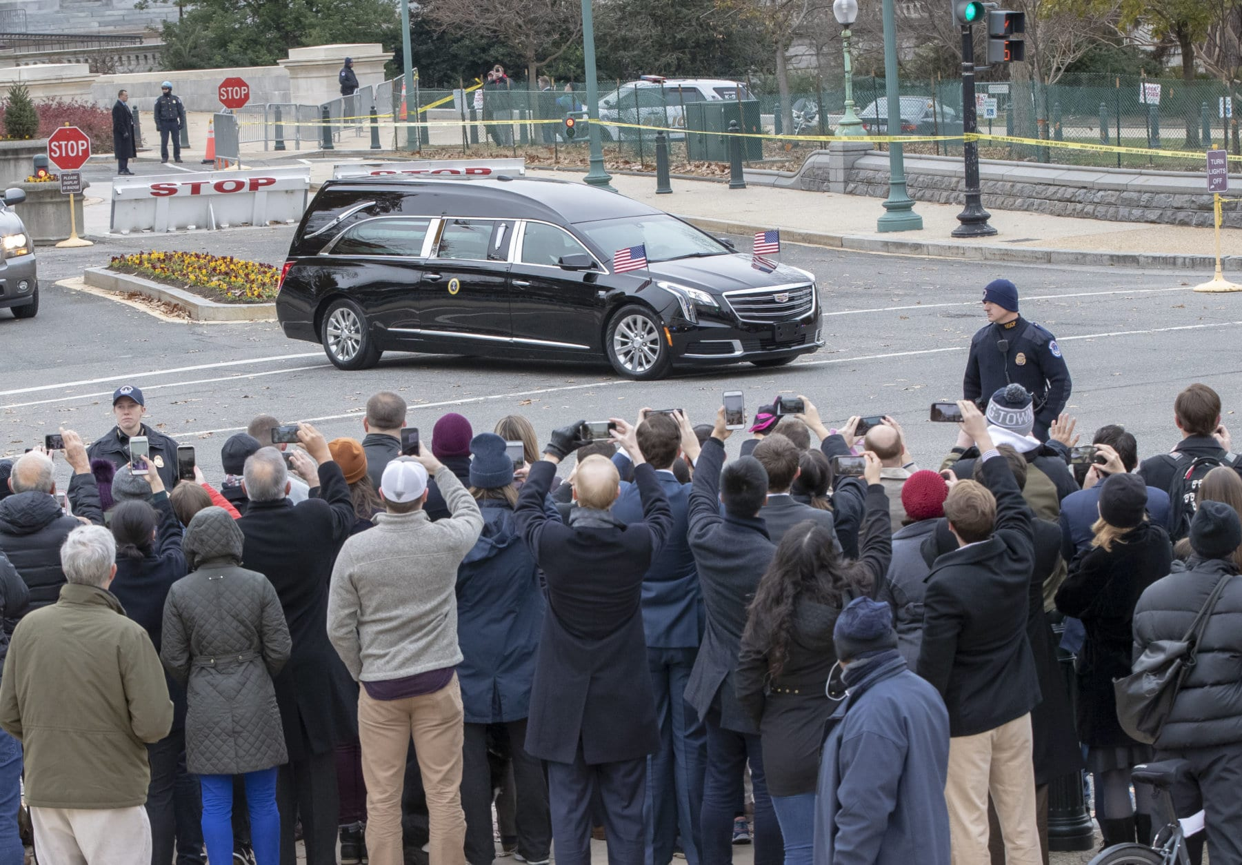 The hearse bearing the casket of former President George H.W. Bush leaves the Capitol on the way to a State Funeral at Washington National Cathedral, Wednesday, Dec. 5, 2018. (AP Photo/J. Scott Applewhite)