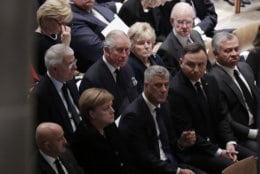 Britain's Prince Charles, second from left, back row, and German Chancellor Angela Merkel, second from left, bottom row, are shown seated during a State Funeral for former President George H.W. Bush at the National Cathedral, Wednesday, Dec. 5, 2018, in Washington. (AP Photo/Evan Vucci)