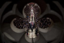 The flag-draped casket of former President George H.W. Bush is carried by a military honor guard into a State Funeral at the National Cathedral, Wednesday, Dec. 5, 2018, in Washington. (AP Photo/Andrew Harnik, Pool)