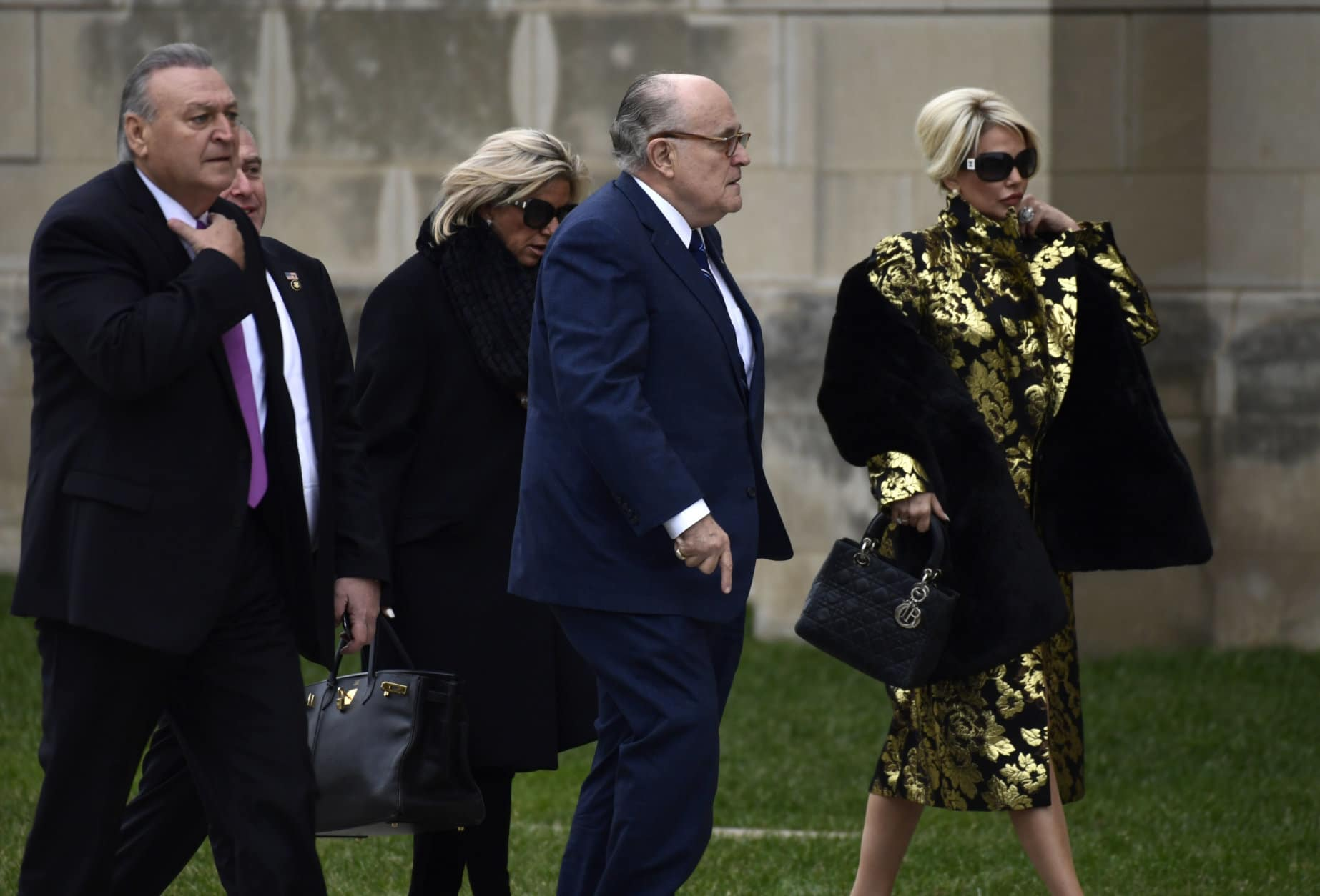 Rudy Guiliani, center, and other guests, arrive for the State Funeral of former President George H.W. Bush at the National Cathedral in Washington, Wednesday, Dec. 5, 2018. (AP Photo/Susan Walsh)