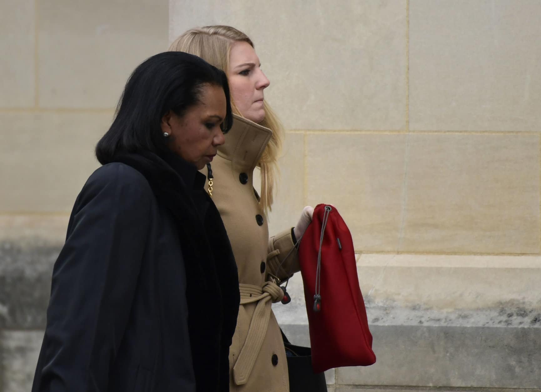 Former Secretary of State Condoleezza Rice, left, arrives for the State Funeral of former President George H.W. Bush at the National Cathedral in Washington, Wednesday, Dec. 5, 2018. (AP Photo/Susan Walsh)