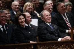 Jeb Bush, Laura Bush, and former President George W. Bush share a laugh as a story is told about former President George H.W. Bush during a State Funeral at the National Cathedral, Wednesday, Dec. 5, 2018, in Washington. (AP Photo/Evan Vucci)