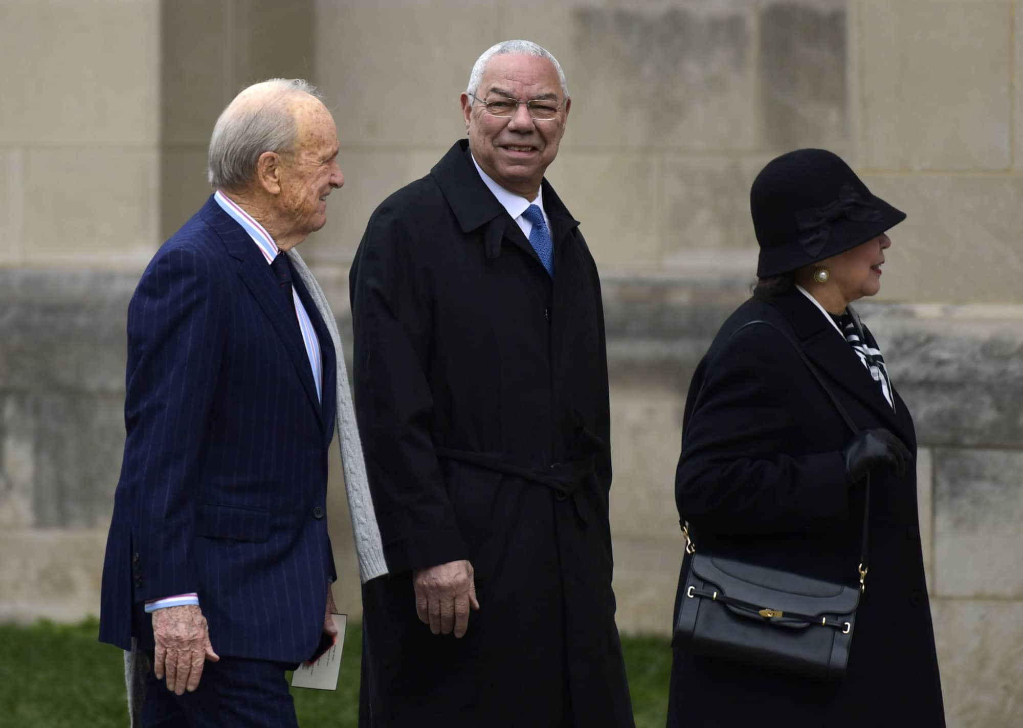 Former Secretary of State Colin Powell, center, arrives for the State Funeral of former President George H.W. Bush at the National Cathedral in Washington, Wednesday, Dec. 5, 2018. (AP Photo/Susan Walsh)
