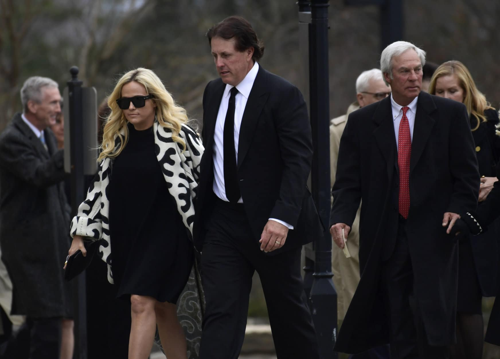 Professional golfer Phil Mickelson, center, arrives for the State Funeral of former President George H.W. Bush at the National Cathedral in Washington, Wednesday, Dec. 5, 2018. (AP Photo/Susan Walsh)
