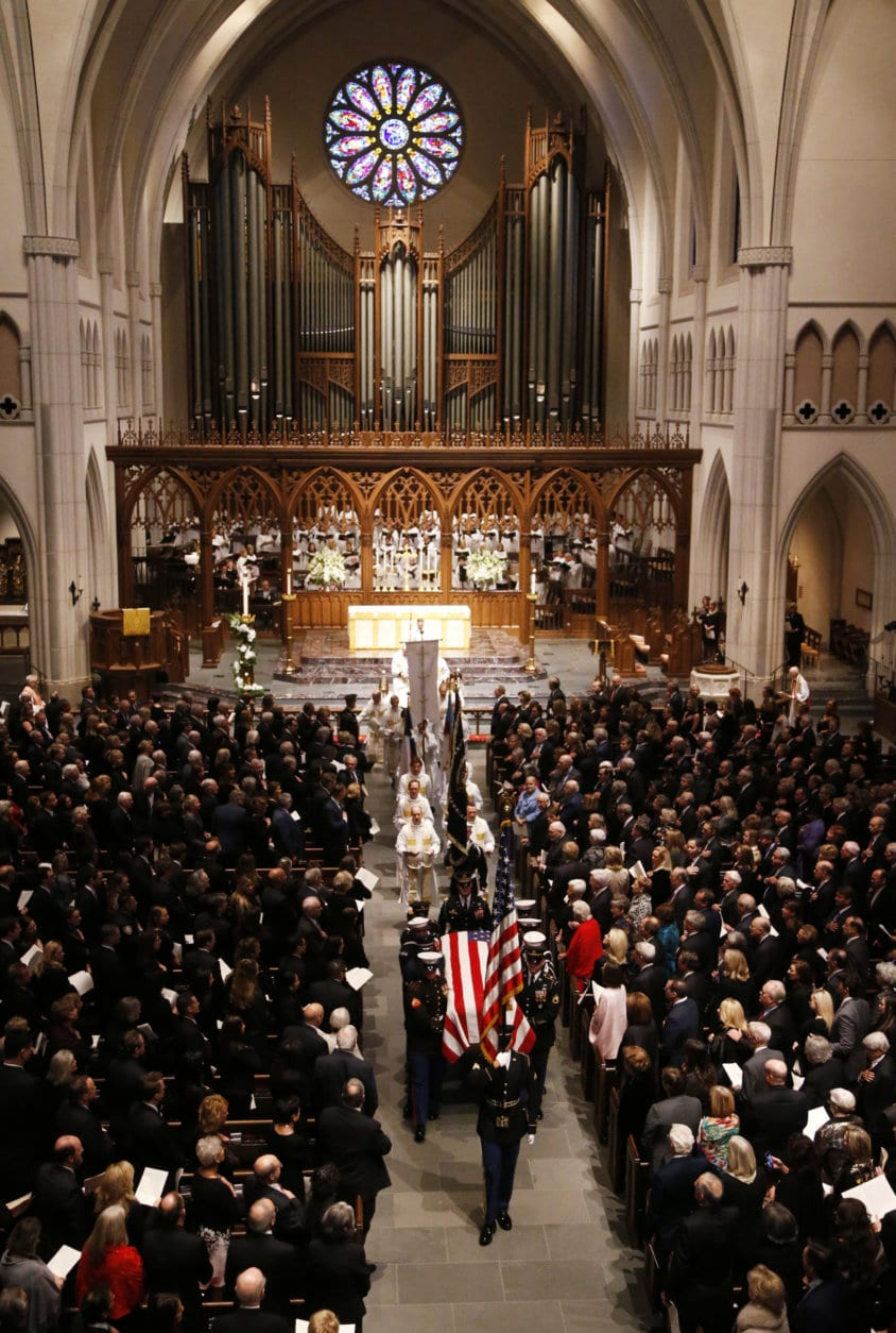The flag-draped casket of former President George H.W. Bush is carried by a joint services military honor guard from St. Martin's Episcopal Church Thursday, Dec. 6, 2018, in Houston. (AP Photo/Mark Humphrey)