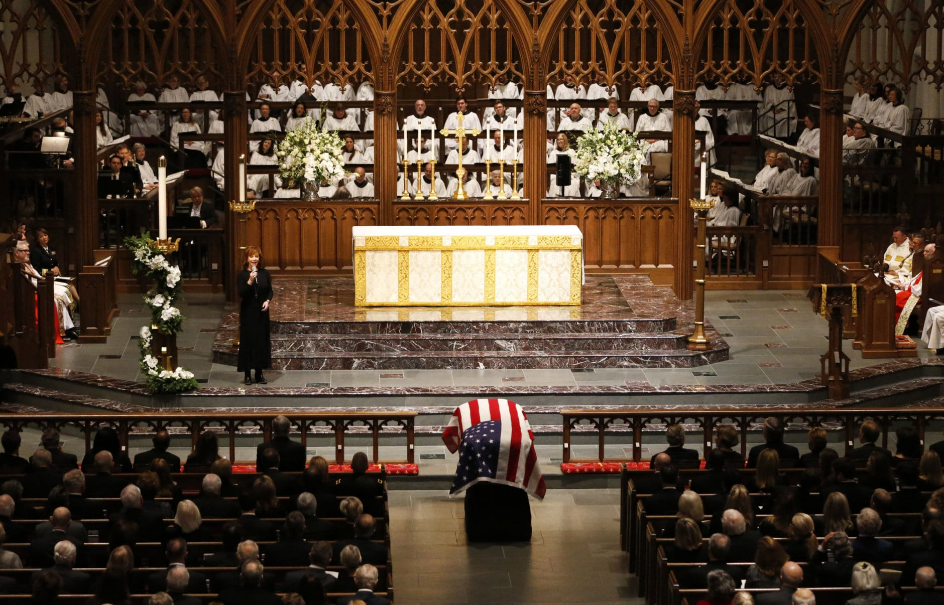 """Reba McEntire sings """"The Lord's Prayer"""" during a funeral service for former President George H.W. Bush at St. Martin's Episcopal Church Thursday, Dec. 6, 2018, in Houston. (AP Photo/Mark Humphrey)"""