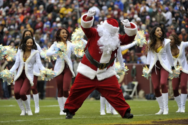 0586150aac4 Washington Redskins cheerleaders perform with Santa Claus during an NFL  football game between the New York Giants and Washington Redskins