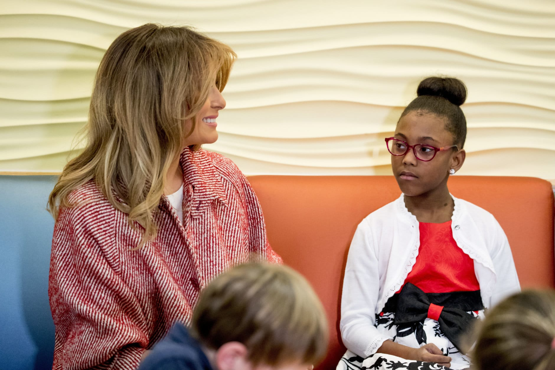 First lady Melania Trump greets children released from the neonatal intensive care unit (NICU) and their parents at Children's National Health System, Thursday, Dec. 13, 2018, in Washington. (AP Photo/Andrew Harnik)