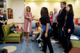 First lady Melania Trump arrives to greet children released from the neonatal intensive care unit (NICU) and their parents at Children's National Health System, Thursday, Dec. 13, 2018, in Washington. (AP Photo/Andrew Harnik)