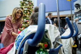 """First lady Melania Trump greets patients in the audience after reading """"Oliver the Ornament"""" to children at Children's National Health System, Thursday, Dec. 13, 2018, in Washington. (AP Photo/Andrew Harnik)"""