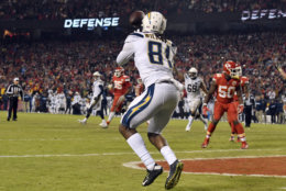 Los Angeles Chargers wide receiver Mike Williams (81) catches a two-point conversion for the win against the Kansas City Chiefs during the second half of an NFL football game in Kansas City, Mo., Thursday, Dec. 13, 2018. The Los Angeles Chargers won 29-28. (AP Photo/Ed Zurga)