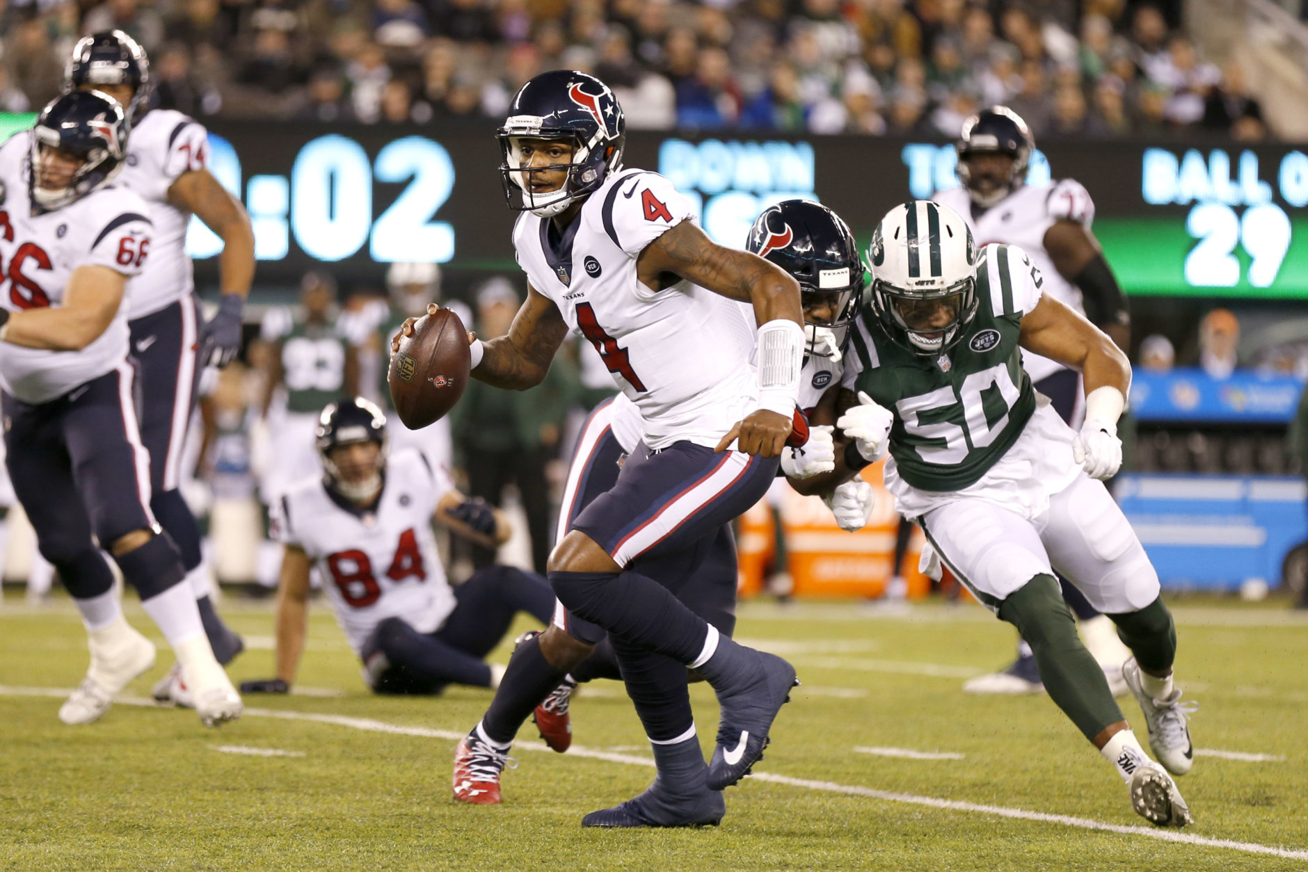 Houston Texans quarterback Deshaun Watson (4) scrambles against the New York Jets during the first half of an NFL football game, Saturday, Dec. 15, 2018, in East Rutherford, N.J. (AP Photo/Adam Hunger)