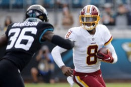 Washington Redskins quarterback Josh Johnson (8) tries to outrun Jacksonville Jaguars defensive back Ronnie Harrison (36) during the first half of an NFL football game, Sunday, Dec. 16, 2018, in Jacksonville, Fla. (AP Photo/Stephen B. Morton)