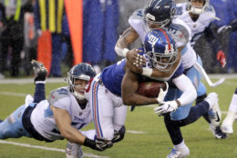 New York Giants wide receiver Jawill Davis, center, is tackled by Tennessee Titans inside linebacker Will Compton, left, and free safety Kevin Byard during the first half of an NFL football game Sunday, Dec. 16, 2018, in East Rutherford, N.J. (AP Photo/Seth Wenig)