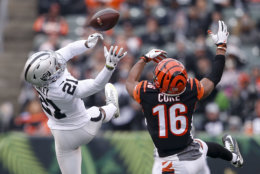 Oakland Raiders cornerback Gareon Conley (21) misses a pass contested by Cincinnati Bengals wide receiver Cody Core (16) in the second half of an NFL football game, Sunday, Dec. 16, 2018, in Cincinnati. (AP Photo/Gary Landers)