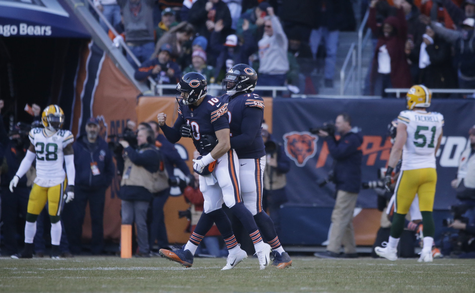 Chicago Bears quarterback Mitchell Trubisky (10) celebrates a touchdown with offensive tackle Charles Leno (72) during the second half of an NFL football game against the Green Bay Packers Sunday, Dec. 16, 2018, in Chicago. (AP Photo/David Banks)