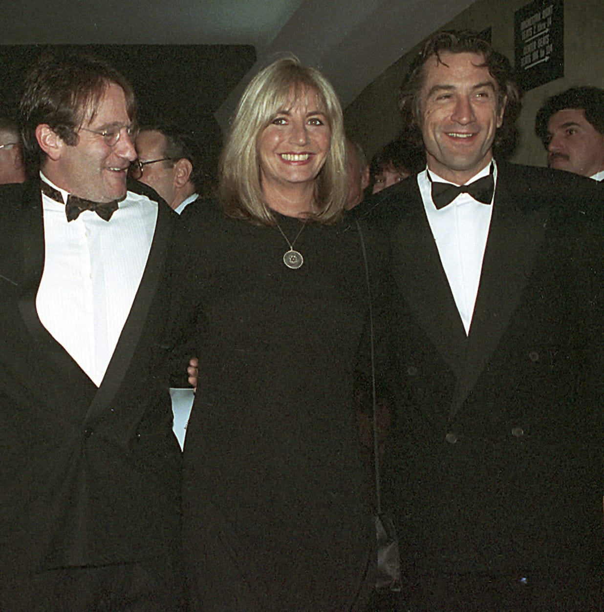 "FILE - In this Dec. 17, 1990 file photo, director Penny Marshall poses with co-stars of ""Awakenings"" Robin Williams, left, and Robert De Niro at the premiere of the film in New York. Marshall died of complications from diabetes on Monday, Dec. 17, 2018, at her Hollywood Hills home. She was 75. (AP Photo/Chrystyna Czajkowsky, File)"
