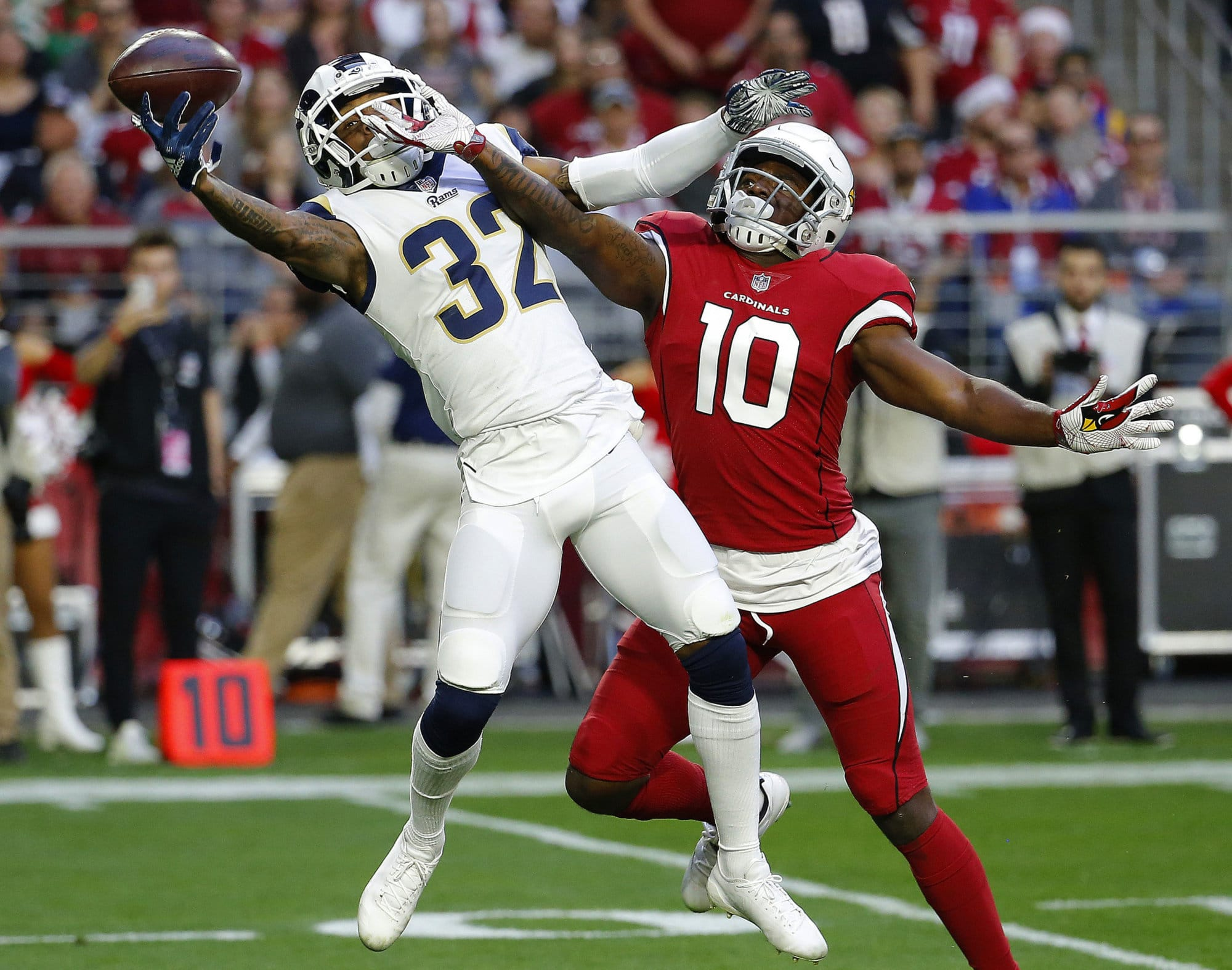 Los Angeles Rams cornerback Troy Hill (32) can't make the catch Arizona Cardinals wide receiver Chad Williams (10) defends during the second half of an NFL football game, Sunday, Dec. 23, 2018, in Glendale, Ariz. (AP Photo/Rick Scuteri)