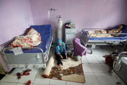 Tsunami survivors sleep at a hospital in Pandeglang, Indonesia, Monday, Dec. 24, 2018. Doctors are working to help survivors and rescuers are looking for more victims from a deadly tsunami that smashed into beachside buildings along an Indonesian strait. The waves that swept terrified people into the sea Saturday night followed an eruption on Anak Krakatau, one of the world's most infamous volcanic islands. (AP Photo/Achmad Ibrahim)